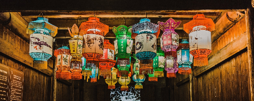 colorful chinese lanterns in alleyway