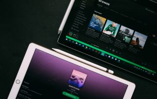 spotify platform on two tablet devices